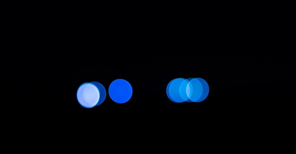 Blue circles of light on a black background
