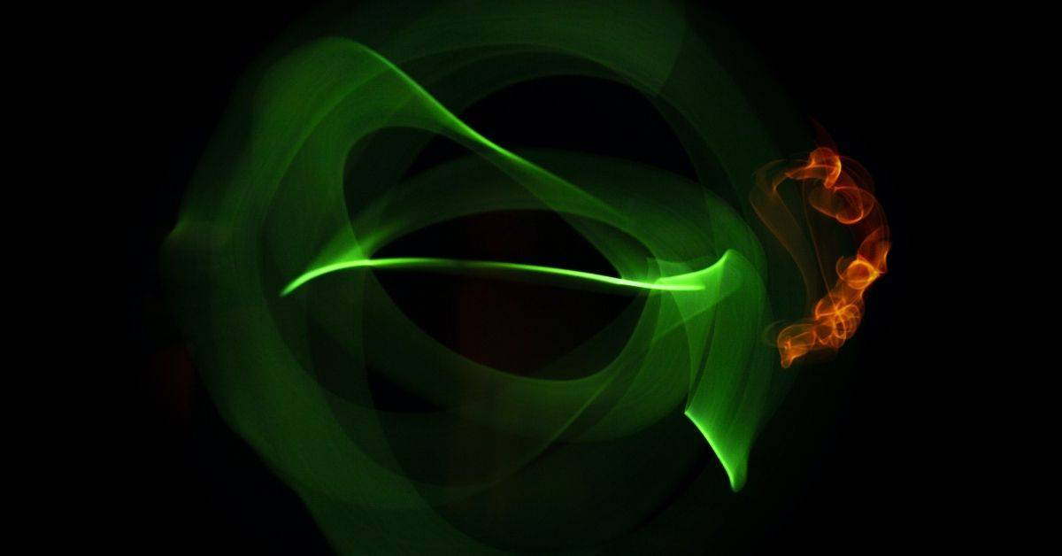 Green and gold light circles on a black background