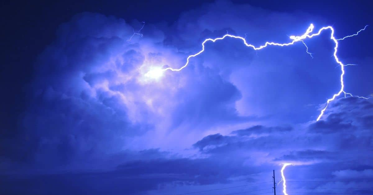 Blue lightning through heavy storm clouds