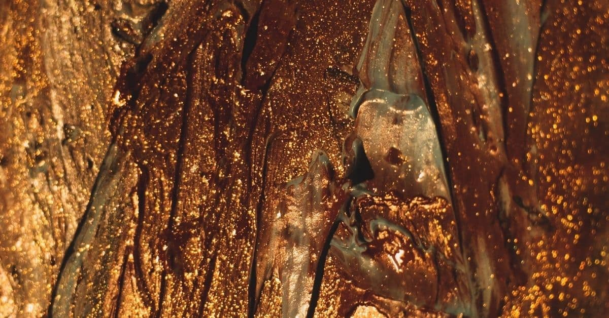 Glittery gold paint in layers