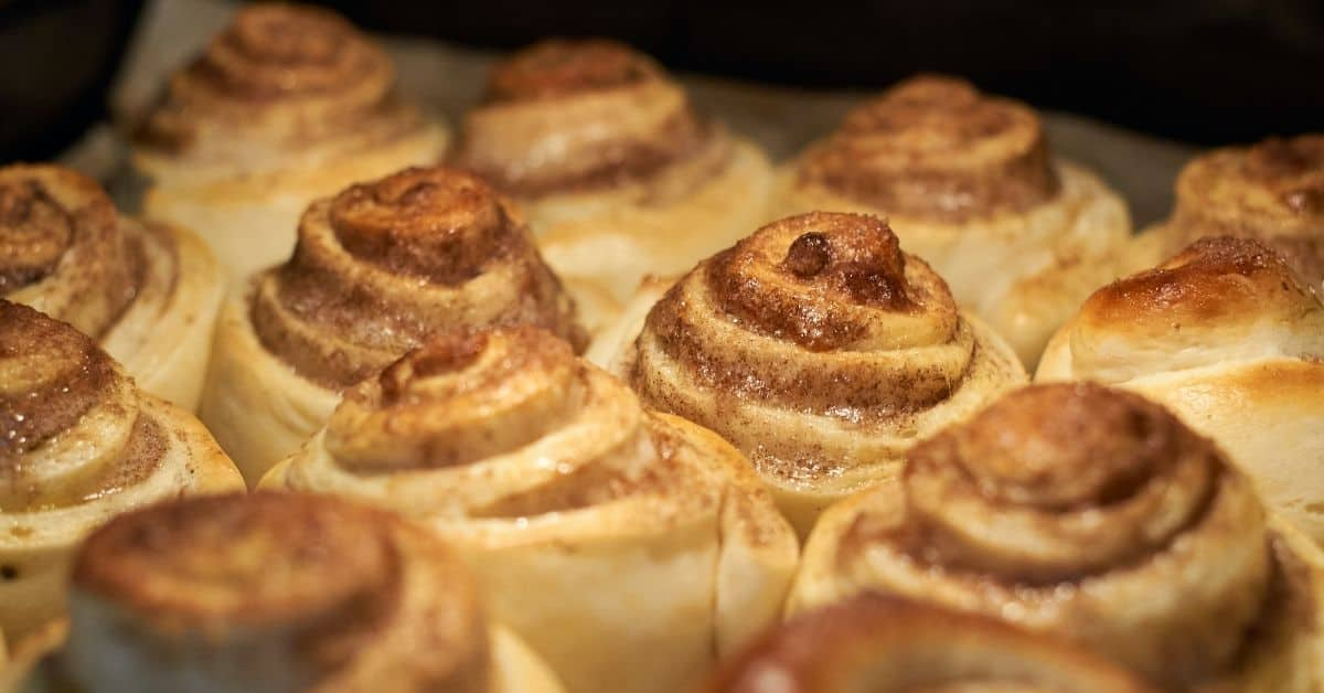 Cinnamon rolls browning in an oven