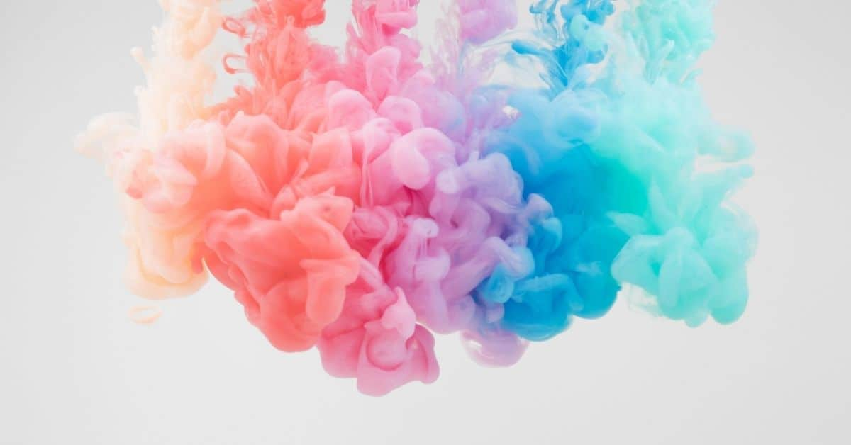 Multicolored ink billowing in water