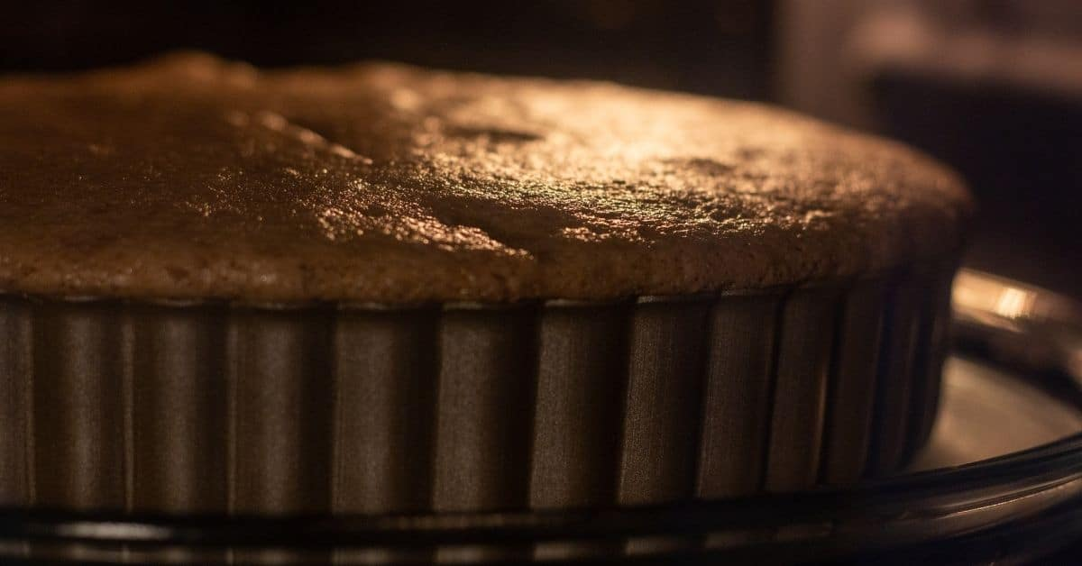 Close up shot of a cake baking in an oven